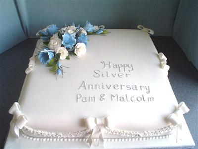 silver-anniversary-cake-with-white-and-blue-flowers