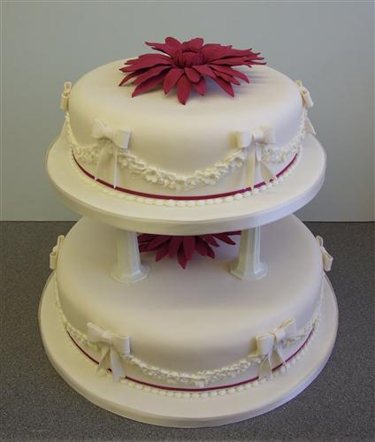 2-tier-round-white-bows-and-garlands