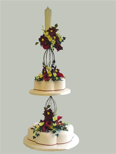 tall-candle-stand-two-tiers-with-yellow-and-deep-red-flowers