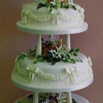 bride-and-groom-three-tier-with-bows-and-garlands