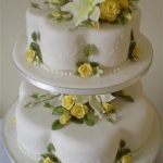 two-tier-yellow-roses-with-bride-and-groom