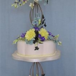 yellow-and-purple-flowers-hex-curves-candle-stand