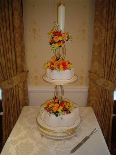 two-tier-with-candle-and-roses